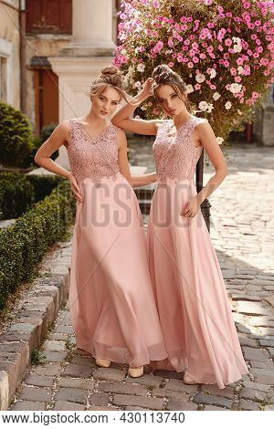 European Girls Bridesmaids In Pink Dresses Having Fun