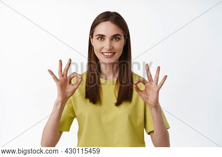 Alright, Yes Very Well. Smiling Young Woman Shows Okay Ok Sign, Zero Problems, Understood Something,