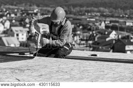 Master Repair Roof. Flat Roof Installation. Roofer Constructing Roof. Man Roofing Surface. Materials
