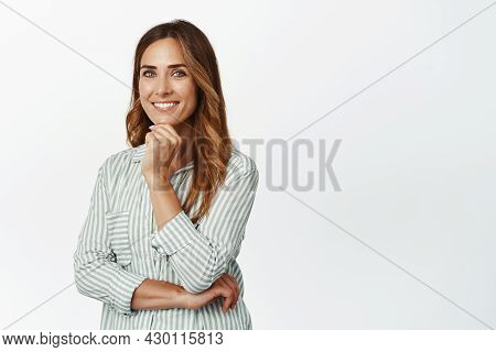 Ambitious Adult Woman In Blouse, Looking Confident And Smiling Happy At Camera, Standing Against Whi