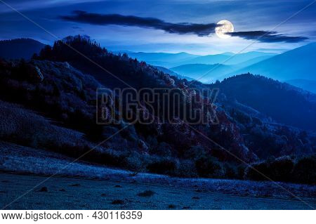 Mountain Scenery In Autumn At Night. Forest In Colorful Foliage On The Hills. Distant Range Beneath
