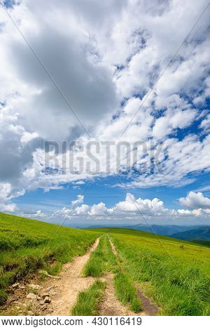 Mountain Landscape On A Sunny Day. Trail Through Grassy Meadow. Beautiful Travel Scenery. Ridge In T