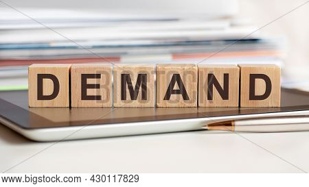 The Word Demand Is Written On Wooden Cubes, Concept