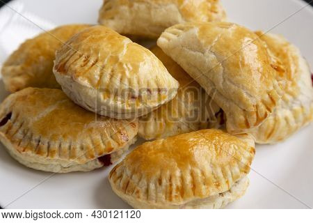 Homemade Cherry Hand Pies On A Plate, Side View. Close-up.