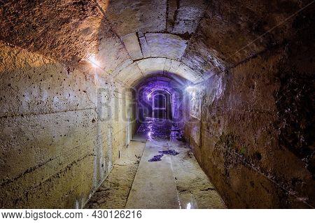 Old Dark Vaulted Underground Flooded Drainage Tunnel.