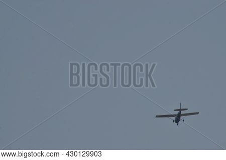 Older Model Piper Type Airplane Circling Slowly Over Canyon, Texas Near Amarillo In The Panhandle  O