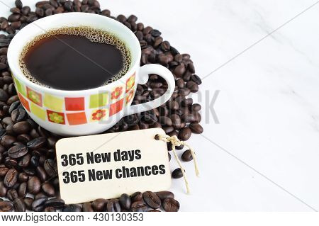 Coffee Beans, A Cup Of Coffee And Label Tag Written With 365 New Days, 365 New Chances