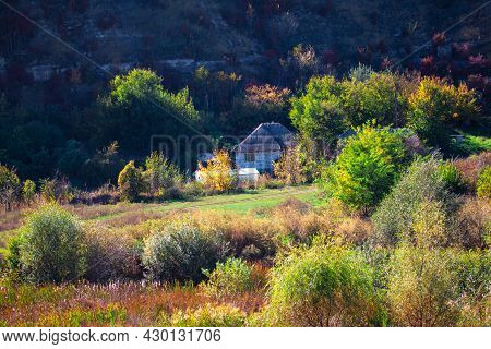 Country House Located At The Foot Of The Mountain . Rustic Settlement In The Autumn