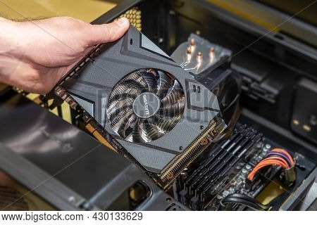 Installing A Video Card Gigabyte On The Motherboard. Installing Computer Components In A Open Pc Cas