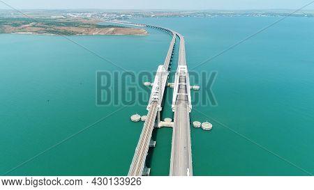 Aerial View Of The Crimean Bridge Across The Kerch Strait. Shot. Amazing Long Bending Bridge Above C