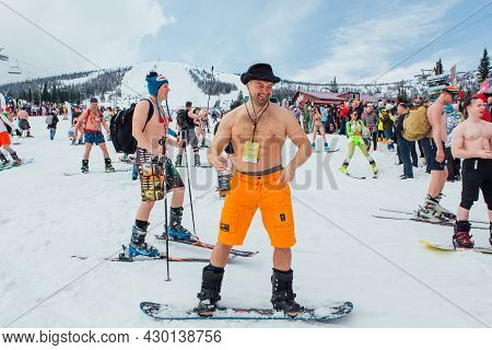 Grelka Fest Is A Sports And Entertainment Activity For Ski And Snowboard Riders In Bikini. Man In Sh
