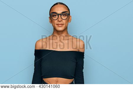 Hispanic transgender man wearing make up and long hair wearing women clothes with a happy and cool smile on face. lucky person.
