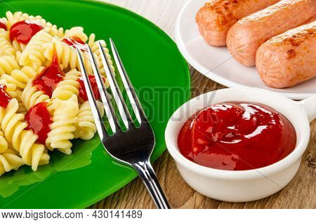 Fork On Green Glass Plate With Boiled Pasta Fusilli With Tomato Ketchup, White Plate With Fried Saus