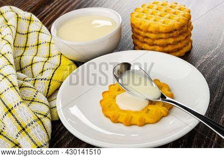 Checkered Napkin, Bowl With Condensed Milk, Stack Of Waffle Cookies, Teaspoon With Condensed Milk On