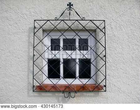 Detail Of An Old Window With A Metal Grating. Lisbon, Portugal