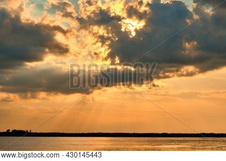 Sunset On The Embankment Of The Amur River In Khabarovsk. The Sunset Over The Horizon.
