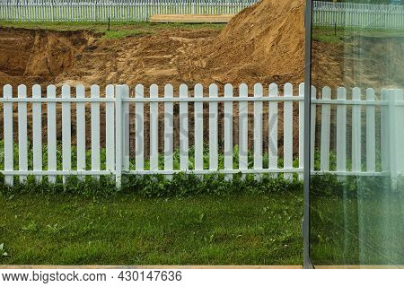 Part Of A Window With Reflection Of A Neighbour Foundation Ditch In Progress