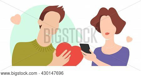 A Man With A Heart Sends Love Signals Online For Dating. Woman With A Phone In Her Hands In A Dating
