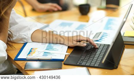 Cropped, Female Auditor Working On Tablet With Accounting Paperworks