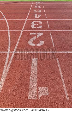 The Curved Lane In Running Track Or Athlete Track In Stadium. Running Track Is A Rubberized Artifici