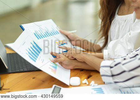 Two Businesswoman Analysing Business Finance Together