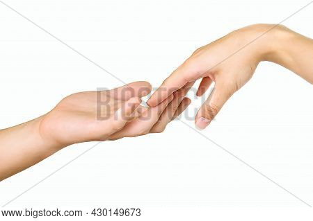 Male And Female Hands On A White Background. The Two Hands Are About To Touch. The Hands Reach Out T