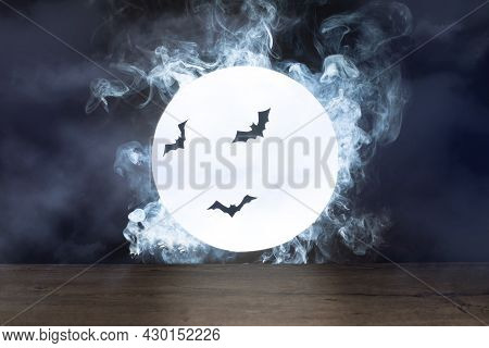 Halloween Background. Spooky Night With Full Moon And Wooden Table. Halloween Scary Night.