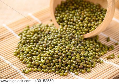 Pile Of Mung Bean Seeds In A Wooden Bowl, Food Ingredients In Asian Cuisine And Produce Mung Bean Sp