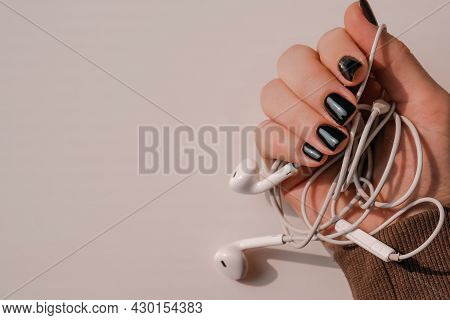 Black Nails Manicure. Minimal Flat Lay Nature. Female Hand. Self Care Nails Female Hand