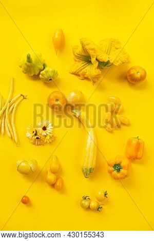 Yellow vegetables on the yellow background