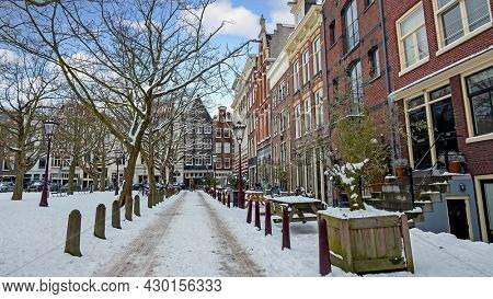 City scenic from a snowy Amsterdm in winter in the Netherlands