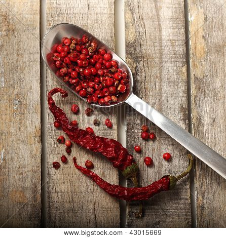 Pepper And Grains On Wooden Background
