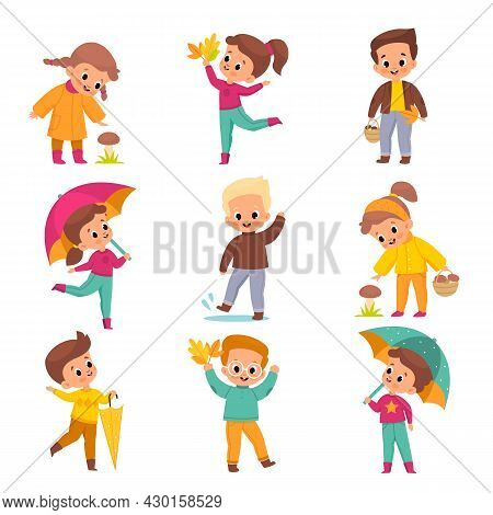 Autumn Kids. Happy Children In Offseason Clothing Playing With Fallen Leaves, Collect Mushrooms, Jum