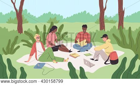 Learning In Park. Students Sitting On Lawn Grass In University Campus. Guys And Girls Spend Time In
