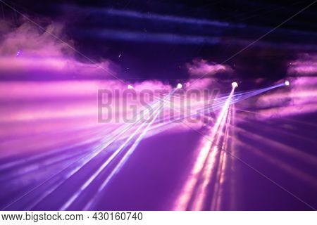 Stage light with colored spotlights and smoke. Concert and theatre scene