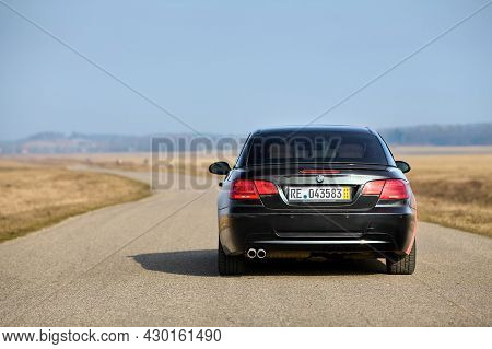Berlin - April 2014: : Bmw 3 Series E93 328i Convertible With M-pack Logo Stripes Outdoors. Rear Bac