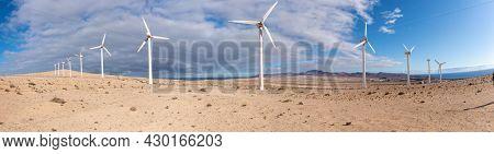 wind turbine in the desert with blue sky  background. wind mill farm in california desert panorama
