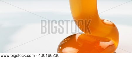honey dripping on a plate