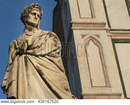 Statue Of The Renaissance Poet Dante Alighieri In Florence Next To The Basilica Of Santa Croce.