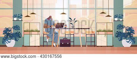 Arab Businessman Sitting At Workplace Arabic Business Man Freelancer Working In Creative Office Hori