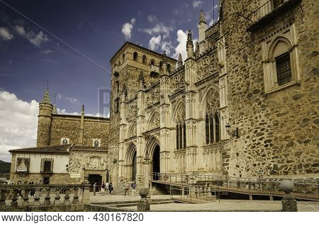 Guadalupe, Cáceres, Spain; 06,05,2021: Main Facade Of The Mudejar Gothic Monastery Of Guadalupe In S