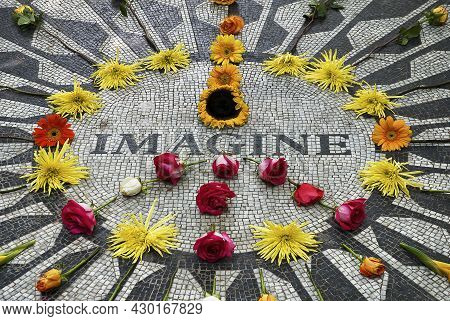 New York,united States; 08;13;2010: John Lennon Memorial With Flowers Making The Peace Symbol At Str