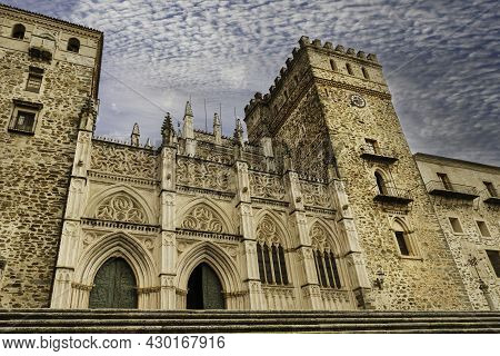 Main Facade Of The Mudejar Gothic Monastery Of Guadalupe In Spain. World Heritage
