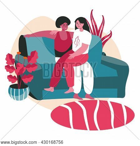 Diverse Homosexual Multiracial Lesbian Couples Scene Concept. Women Hugging While Sitting On Sofa. F