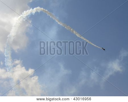 T-6 Texan Fighter In Sky With Smoke Trace