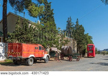 Matjiesfontein, South Africa - April 20, 2021: A Street Scene, With Vintage Vehicles, In The Histori