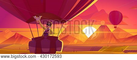 Hot Air Balloon Travel. Excited Man With Dove On Hand Flying Above Mountains In Sunset Sky Scenery L