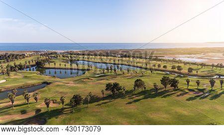 Green Golf Courses By The Sea. Salgados Beach. Portugal, Albufeira. Aerial View, Sunny Day In Algarv