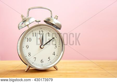 Retro Alarm Clock On Bright Light Pink Background With Copy Space. Time Concept