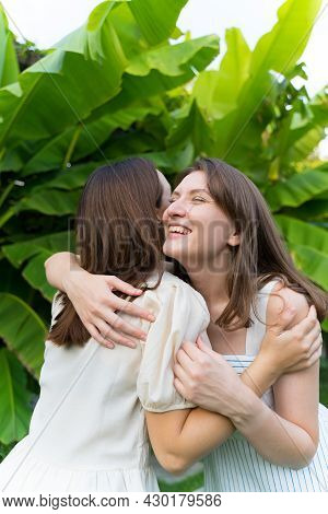 Two Young Friends Met After Quarantine. Hugs. Friendship And Family. Happy Sisters Smile And Hug Aft
